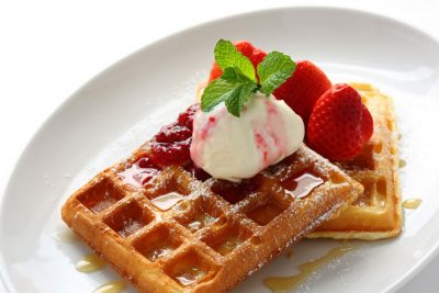 Sweet-waffle-with-jam-strawberries-and-icecream