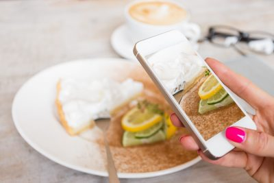Woman-taking-photo-restaurant